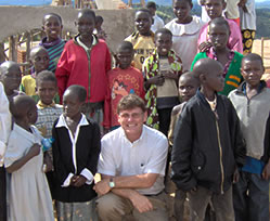 Dr. Bryan Thatcher with children in Kibeho