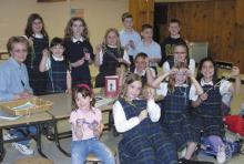 this prayer group from St. Ann School in Hornell, NY, raised money to help Mother of Mercy Messengers (MOMM) bring the Divine Mercy message to the parish.